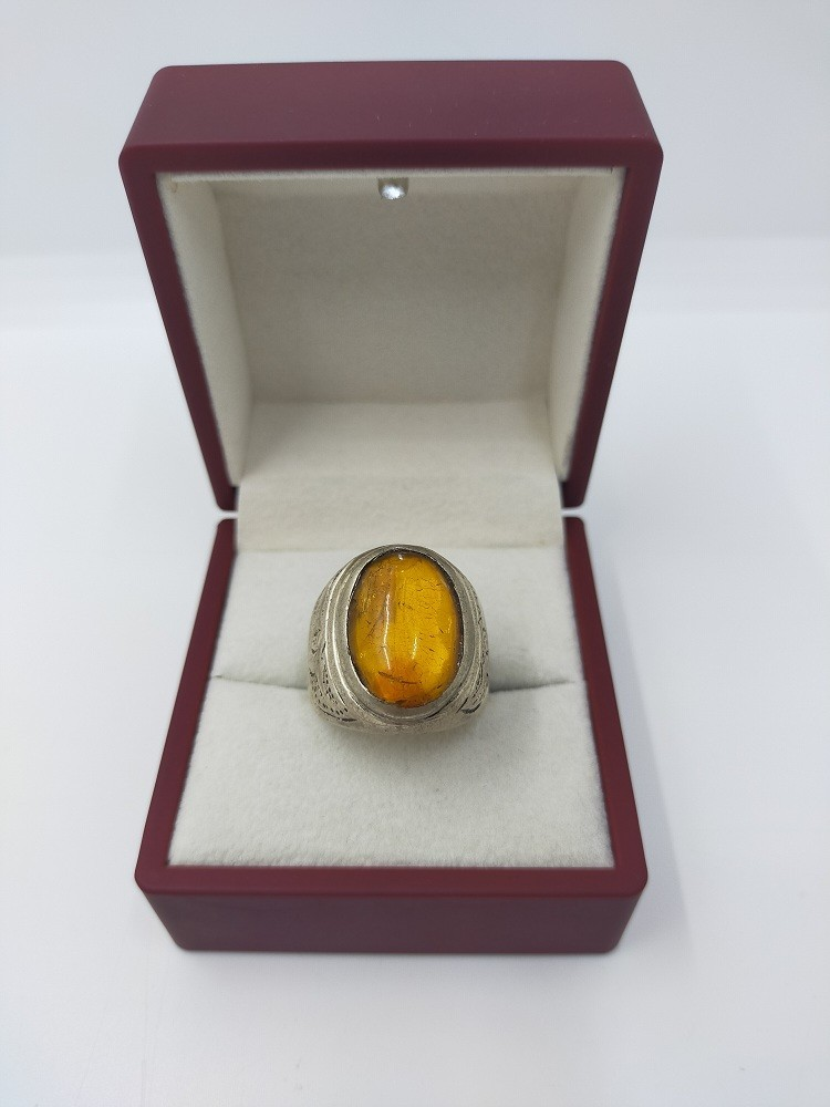 Ring with  amber stone